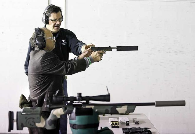 Andy Loeffler of Black Wing Shooting Center instructs Rep. Mike Sheehy, D-Oregon (Columbus Dispatch)
