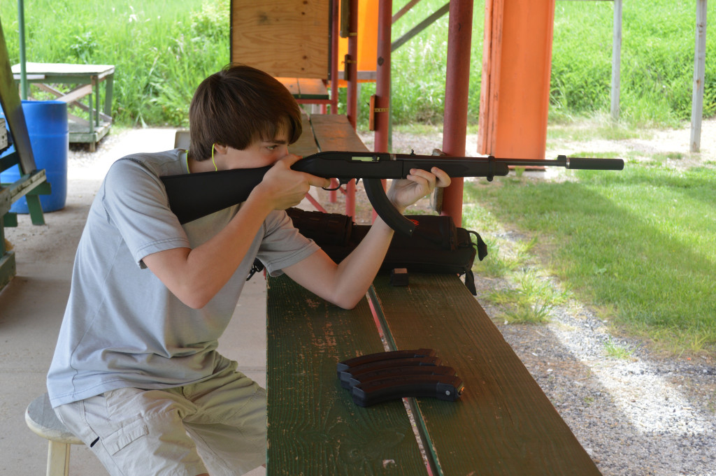 The author's little brother shooting the 10/22 Takedown through the Mack Brothers Echo